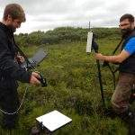 taking field spectrometer measurements on the arctic tundra